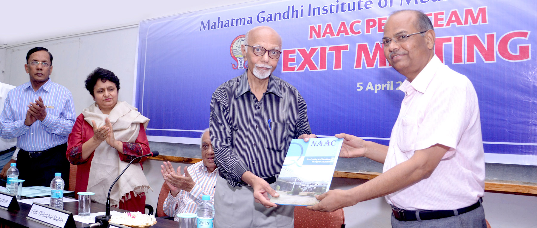 Dr S Rangaswami, Chairperson of the NAAC Peer Team, handing over the Peer Team Report to Dr KR Patond, Dean MGIMS